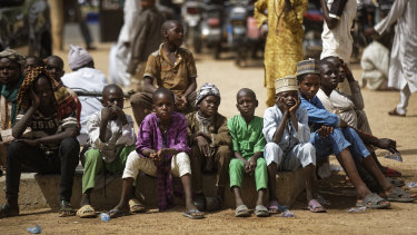 Young Muslim boys wait for traditional Friday prayers to begin at a mosque in Kano, northern Nigeria.