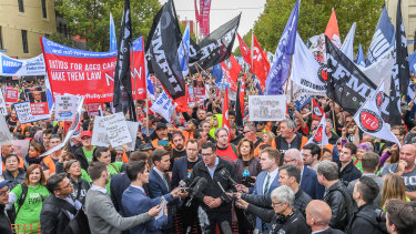Daniel Andrews talks to the media before the Change the Rules union rally.