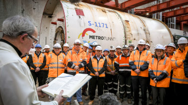 Catholic priest Father Anthony Bernal blesses Joan, a Metrol Tunnel boring machine.