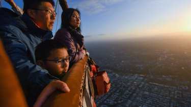 Wei Chen and Zhu Yi Qi, with their son Zhu Si Yun, were among the last Chinese tourists at Global Ballooning Australia this week as the travel ban kicked in.