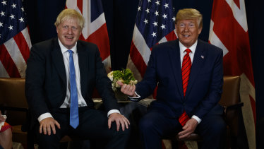 Hair apparent: Boris Johnson with Donald Trump this week.