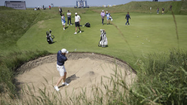 England's Sam Horsfield plays out of a bunker on the 6th green during a practice round for the British Open on Tuesday.