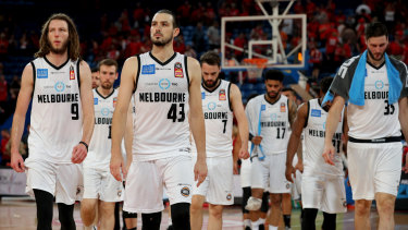 Opportunity lost: Melbourne United players leave the court after losing game three of the finals series to Perth on Friday night.