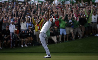 April 14, 2013: Adam Scott makes a birdie putt on the second playoff hole to win the Masters at Augusta.