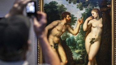 """Visitors look at the painting """"Adam and Eve"""" by Flemish master Peter Paul Rubens in the Rubenshouse in Antwerp, Belgium."""