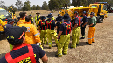 Rural firefighters are seen preparing to fight fires at Spicers Gap, south west of Brisbane, on Wednesday.
