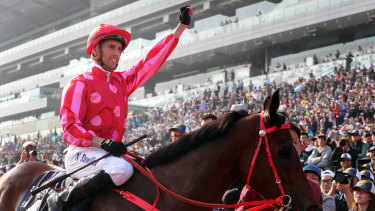 Happier times: Nash Rawiller celebrates victory in the group 1 Hong Kong Sprint aboard Mr Stunning in December.