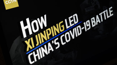 """The title screen of a programme called """"How Xi Jinping Led China's COVID-19 Battle"""", from the CGTN archive is seen as it plays on a computer monitor in London."""