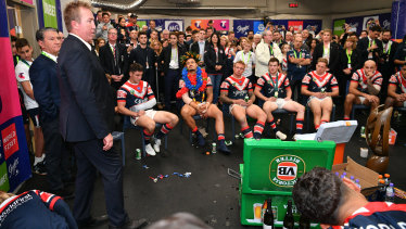 Trent Robinson addresses the Roosters players after last year's grand final victory.