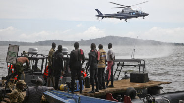 A helicopter searches on Sunday for victims of a boat accident on Lake Victoria, near the Ugandan capital Kampala.