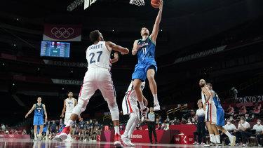 Slovenia's Jaka Blazic (11) drives to the basket over France's Rudy Gobert (27).