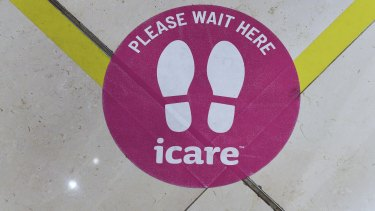 A sticker on the floor in the foyer of icare's building in Sydney.