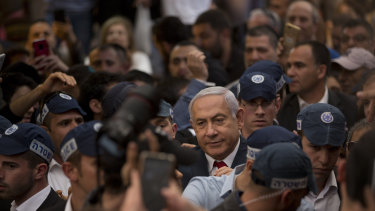 Israeli Prime Minister and head of the Likud party Benjamin Netanyahu at a market in Tel Aviv.