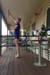 Romy from Prahran and Carminda from Brisbane decorate Block D at  Howard Springs on Christmas Eve.