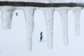 Skiers and snowboarders at Perisher in the Snowy Mountains in August.