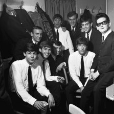 The Beatles pose with Roy Orbison and Gerry and the Pacemakers backstage in their dressing room during a 1963 British tour. From left: Paul McCartney, Freddie Marsden (behind), George Harrison, Gerry Marsden, Ringo Starr (back), Les Maguire (back), John Lennon, John 'Les' Chadwick (back), Roy Orbison.