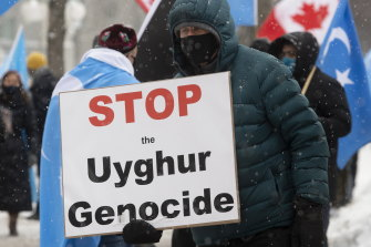Protesters decry China's treatment of Muslims Uighurs outside Parliament in Ottawa, Canada.