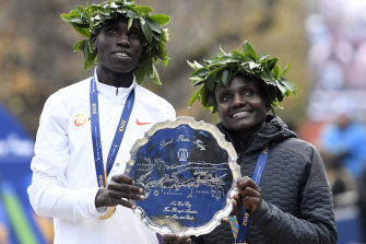 Geoffrey Kamworor and Joyciline Jepkosgei of Kenya pose with the trophy after winning the Mens' and Womens' Division of the 2019 TCS New York City.