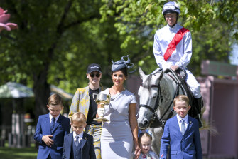 Jockey Kerrin McEvoy and wife Cathy with their children at the launch of the Melbourne Cup Carnival.