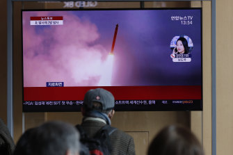People in Seoul watch a news program reporting that North Korea had fired two projectiles on Monday.