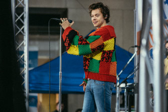 Piece of the pandemic ... Harry Styles wearing the JW Anderson cardigan that became an online sensation.