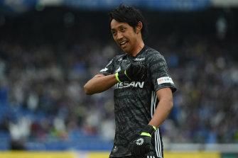 Yokohama F. Marinos goalkeeper Park Iru-gyu celebrates the team's opening goal on Saturday.