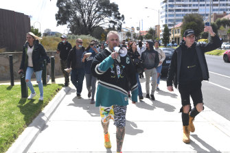 Protesters march along Marine Parade in St Kilda.