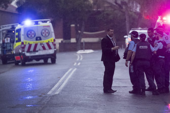Police at the scene in Henry Street, Lewisham, where a man was shot dead and another man was in a critical condition.