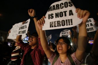 November 2016: Protesters oppose the burial of former Philippines dictator Ferdinand Marcos at the People's Power Monument in Quezon city, north of Manila.