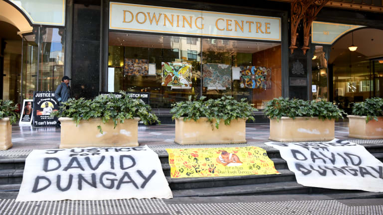 """Banners reading """"Justice for David Dungay"""" outside the Downing Centre Court in Sydney on Monday."""