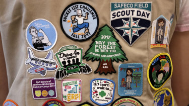Patches cover the back of a US Girl Scout's vest at a demonstration of some of their activities in Seattle.