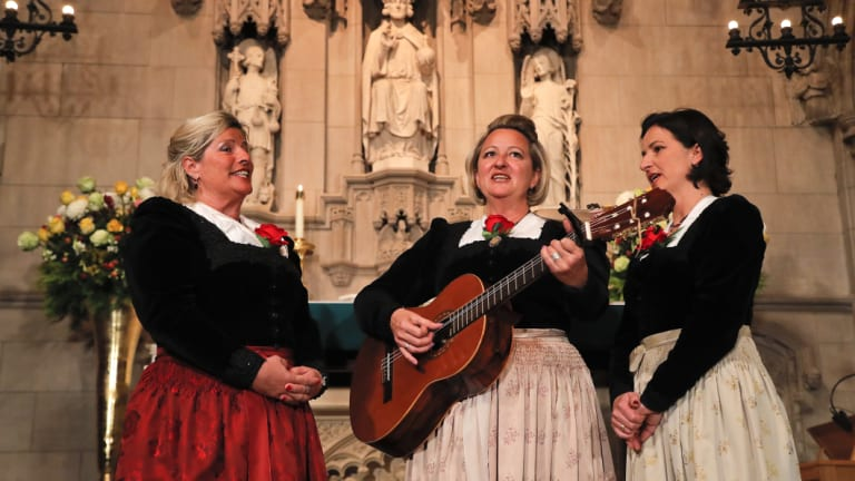 "The Kroell Family Singers sing  during a celebration of the song ""Silent Night"" at Trinity Church in New York."