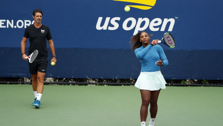 Common practice: Serena Williams with her coach Patrick Mouratoglou at last year's US Open.