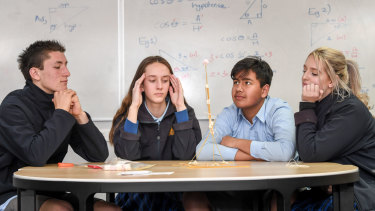 Frankston High School students build a tower with 24 sticks of spaghetti, one metre of tape and string. A marshmallow has to sit on the top. Left to right: Kye Munnikhuis, Keily Blackley, Sam Lutfi and Yasmin Hume.
