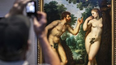 "Visitors look at the painting ""Adam and Eve"" by Flemish master Peter Paul Rubens in the Rubenshouse in Antwerp, Belgium."