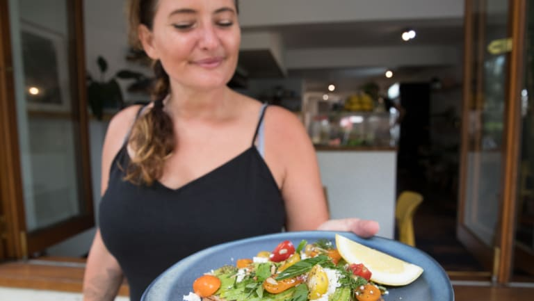 Anne Cooper with a plate of avocado toast at Morris in Paddington.