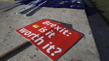 Brexit banners lie on the ground near Parliament in London.