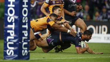 Jesse Bromwich dives for the try against the Broncos in Storm's season-opening win.