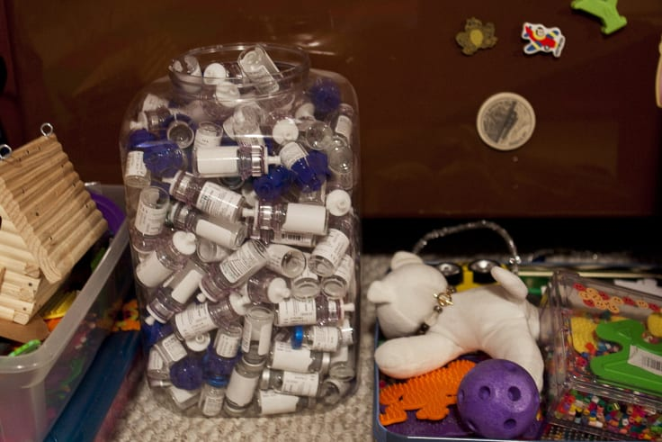 A collection of empty bottles of haemophilia medication at a home in Falmouth, Maine.