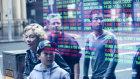 Australian shares fell off a 13-month high.