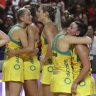 Australia's players stand on court after losing the Netball World Cup final to New Zealand.