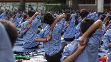 Tibetan student practise yoga at the Tibetan Children's Village School in Dharmsala, India