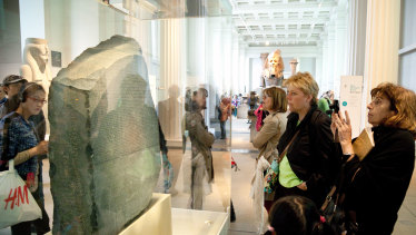British Museum visitors view  the Rosetta Stone in London.