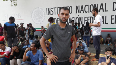 Rahjit, from India, waits to register his entry into Mexico, along with thousands from Nigeria, Cameroon, Bangladesh, Haiti and Cuba who travelled across oceans, jungles and mountains, up through Central America to get closer to the US.