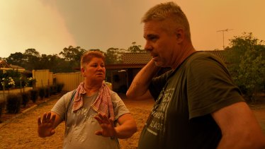 Sandy and Brian Castle monitor the situation at their home on Yanderra Road.