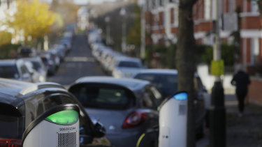 Build back greener: an electric car charges on a street charging port in London.