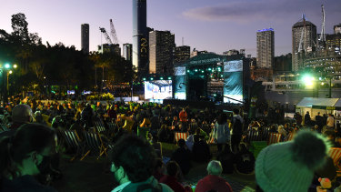 Crowds watch the announcement of Brisbane's win.