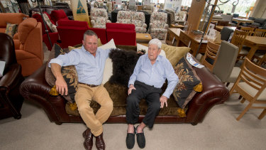 Peter Cusack and his father David, 88, in the Fyshwick showroom of Cusacks Furniture.