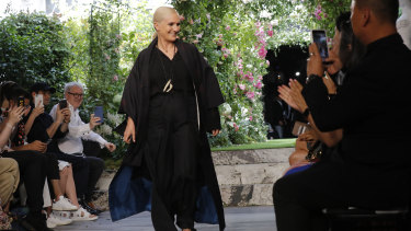 Designer Maria Grazia Chiuri accepts applause at the end of the Dior Haute Couture Fall-Winter 2020 fashion collection presented in Paris on Monday July 1, 2019.