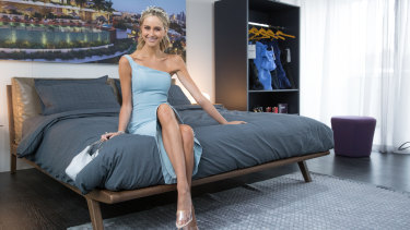 Model Sarah Czarnuch tests the $60,000 mattress at the Pace Penthouse marquee at Flemington.